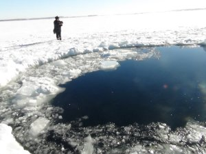 Associated Press - A circular hole in the ice of Chebarkul Lake where a meteor reportedly struck the lake near Chelyabinsk, about 1500 kilometers (930 miles) east of Moscow, Russia, Friday, Feb. 15, 2013.