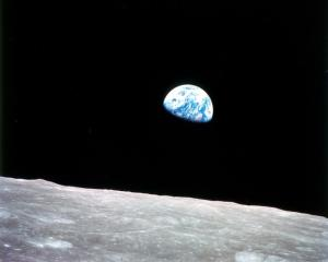 "Earthrise Apollo 8, the first manned mission to the moon, entered lunar orbit on Christmas Eve, Dec. 24, 1968. That evening, the astronauts—Commander Borman, Command Module Pilot Jim Lovell, and Lunar Module Pilot William Anders—held a live broadcast from lunar orbit, in which they showed pictures of the Earth and moon as seen from their spacecraft. Said Lovell, ""The vast loneliness is awe-inspiring and it makes you realize just what you have back there on Earth."" They ended the broadcast with the crew taking turns reading from the book of Genesis."