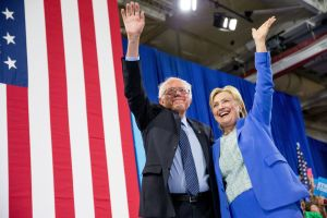 Democratic presidential candidate Hillary Clinton and Sen Bernie Sanders, I-Vt, wave to supporters as Sanders endorsed Clinton during a rally in Portsmouth, New Hampshire, Tuesday AP Photo/Andrew Harnik Japan Today